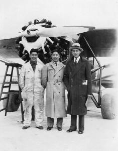Joy Thom, Moon Chin, and Donald Wong in front of a Stinson Detroiter