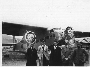 Donald Wong, 2nd from left; Harold Bixby, 2nd from right; in front of a Ford Trimotor in China